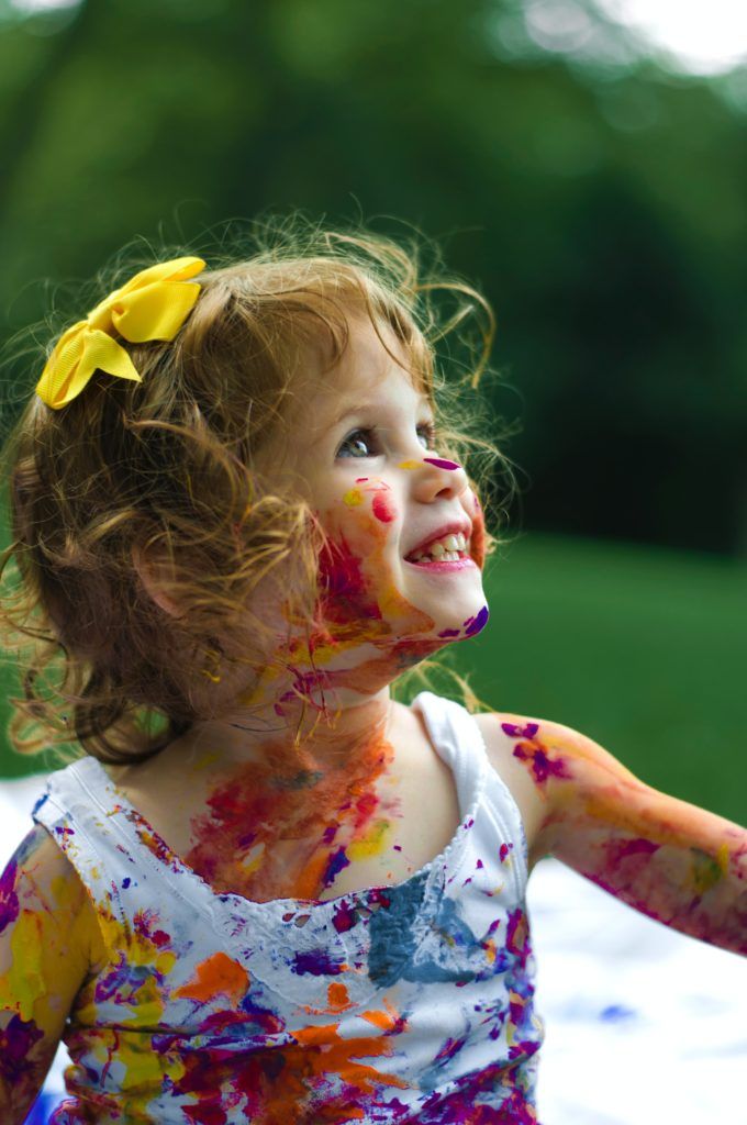 Little girl with paint all over her face - why you need a house cleaning service - maidstr